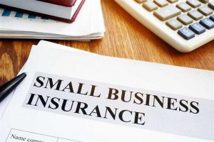 "piece of paper that says ""small business insurance"""